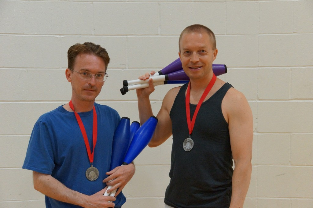 Leif Pettersen (right) wearing his silver medal from the International Jugglers' Association 2014 championships