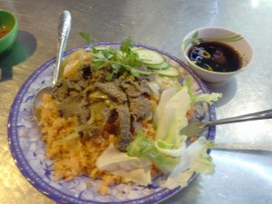 Stiry fried beef and onion with orange rice