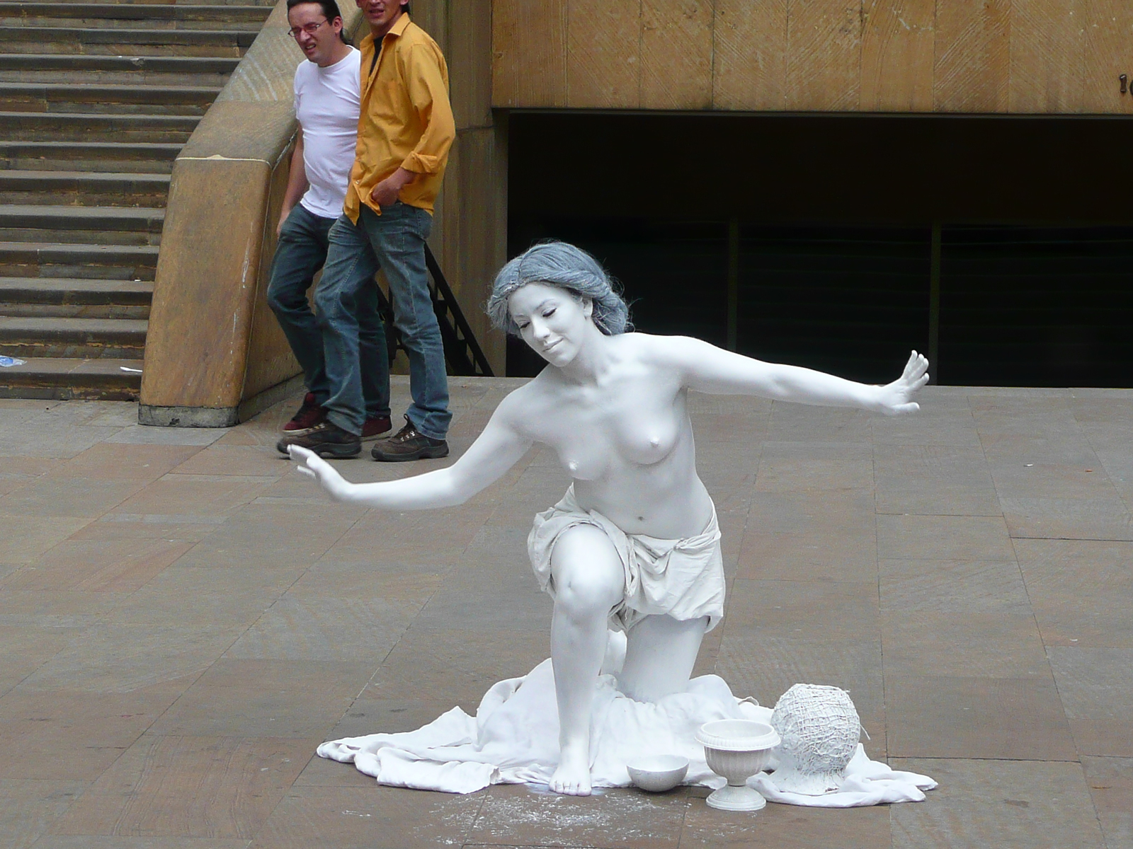 Topless living statue