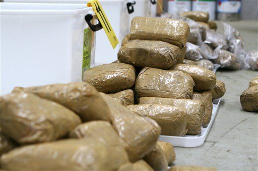 Packages containing methamphetamine are stacked in a warehouse in Melbourne, Australia. (AP Photo/Australian Federal Police, HO)